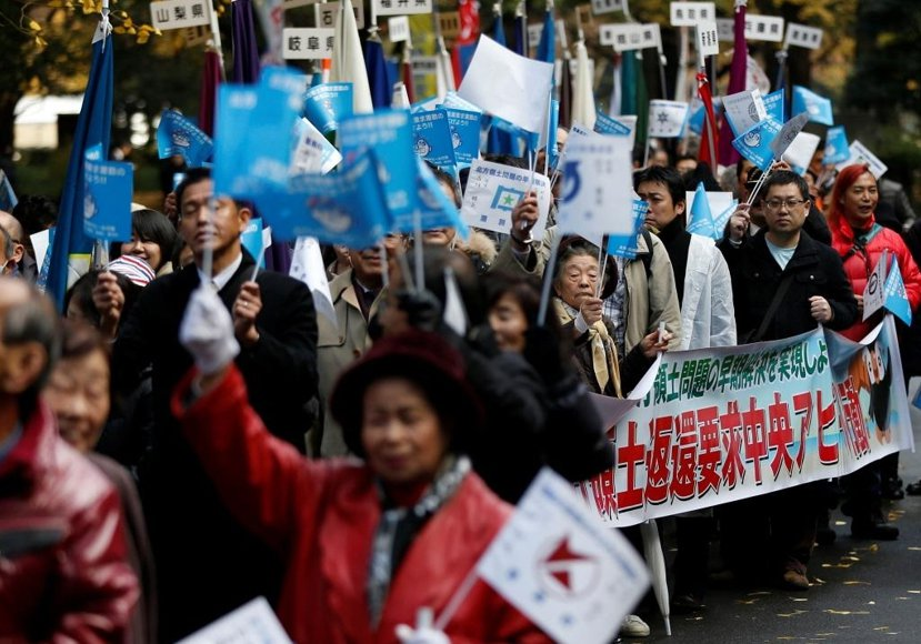 今年12月1日東京街頭陸續出現要求俄羅斯歸還北方領土的示威抗議。 圖/路透社