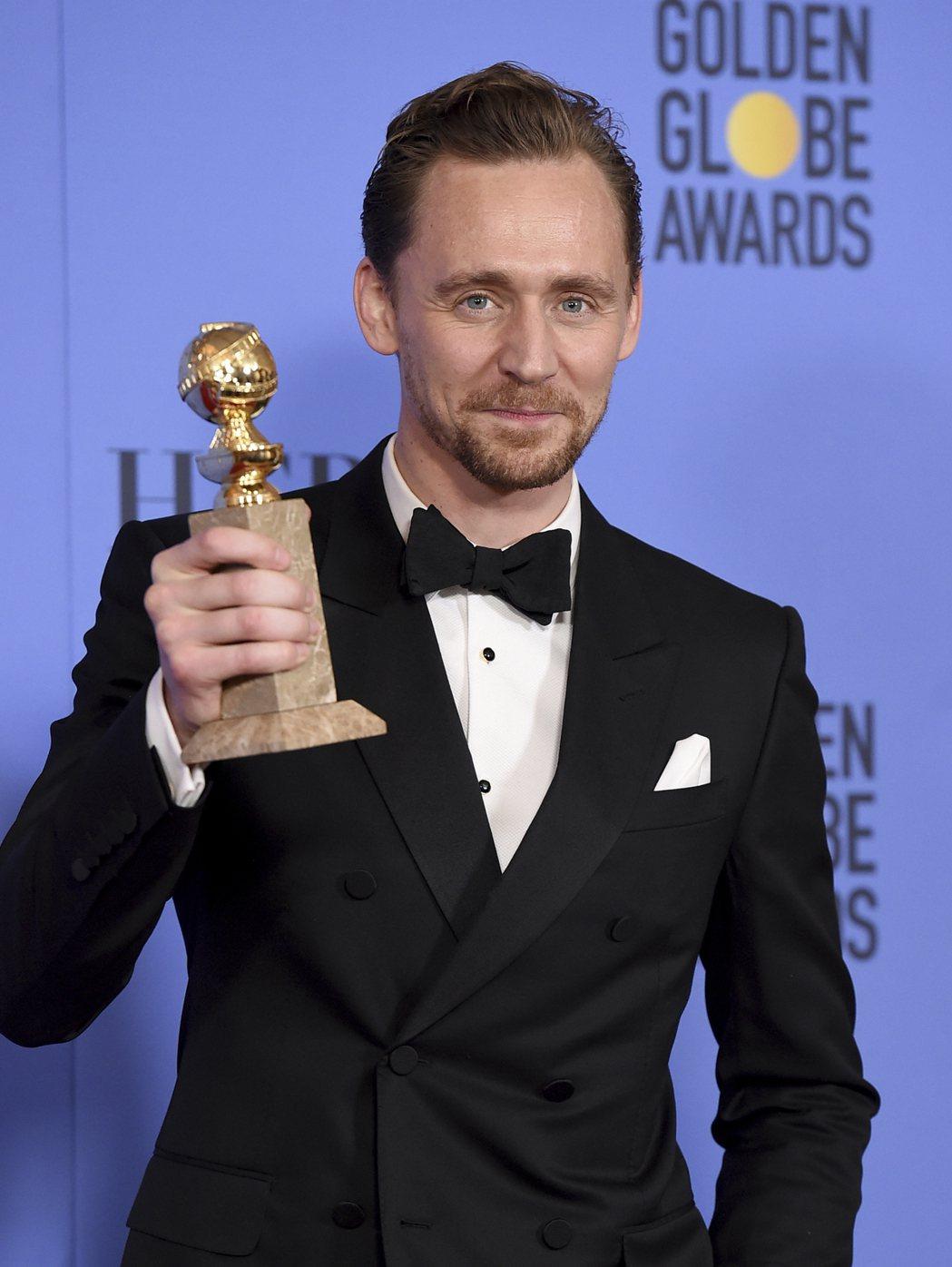 湯姆希德斯頓獲金球獎最佳電視電影或迷你影集男主角獎。圖/美聯社
