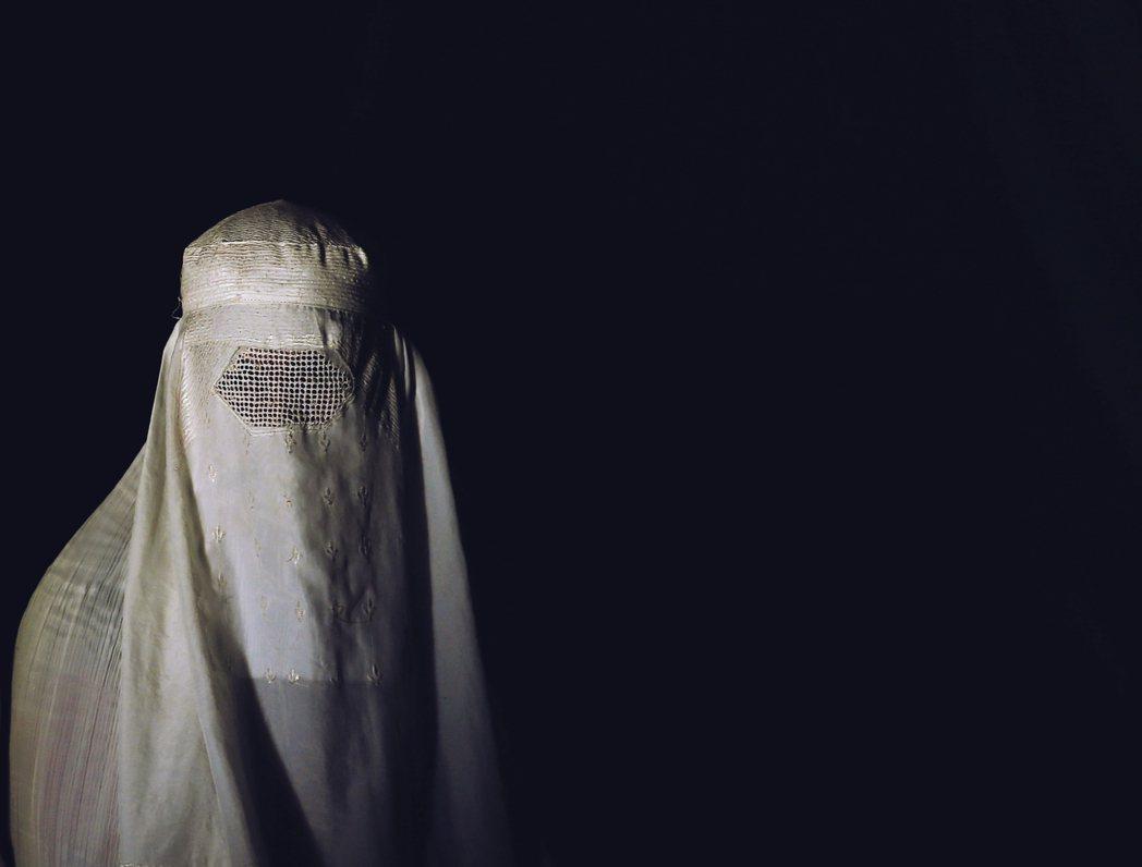 資料圖片,布卡(burqa):支持派認為,伊斯蘭經典本來就沒有規定穆斯林非得「包...