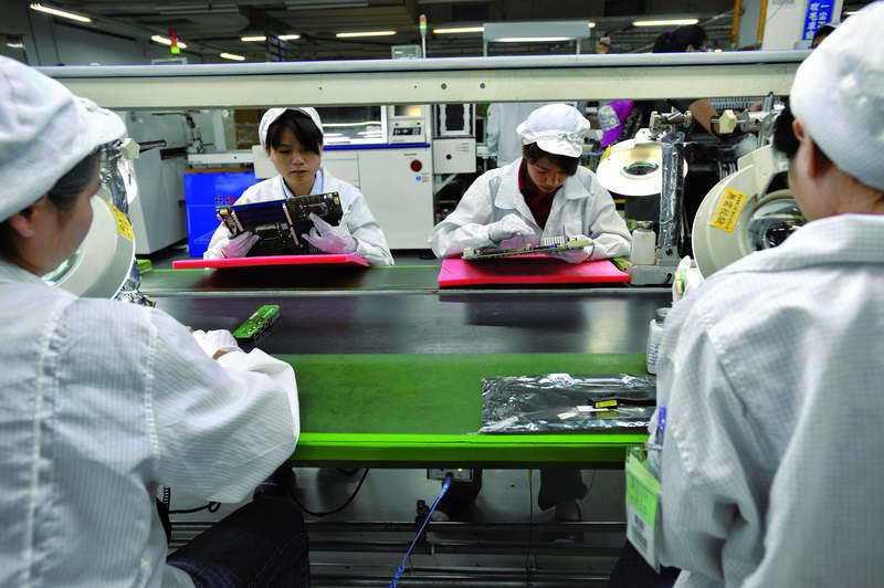 過去中國便宜的勞動力,是鴻海成功的因素。 ◎法新社