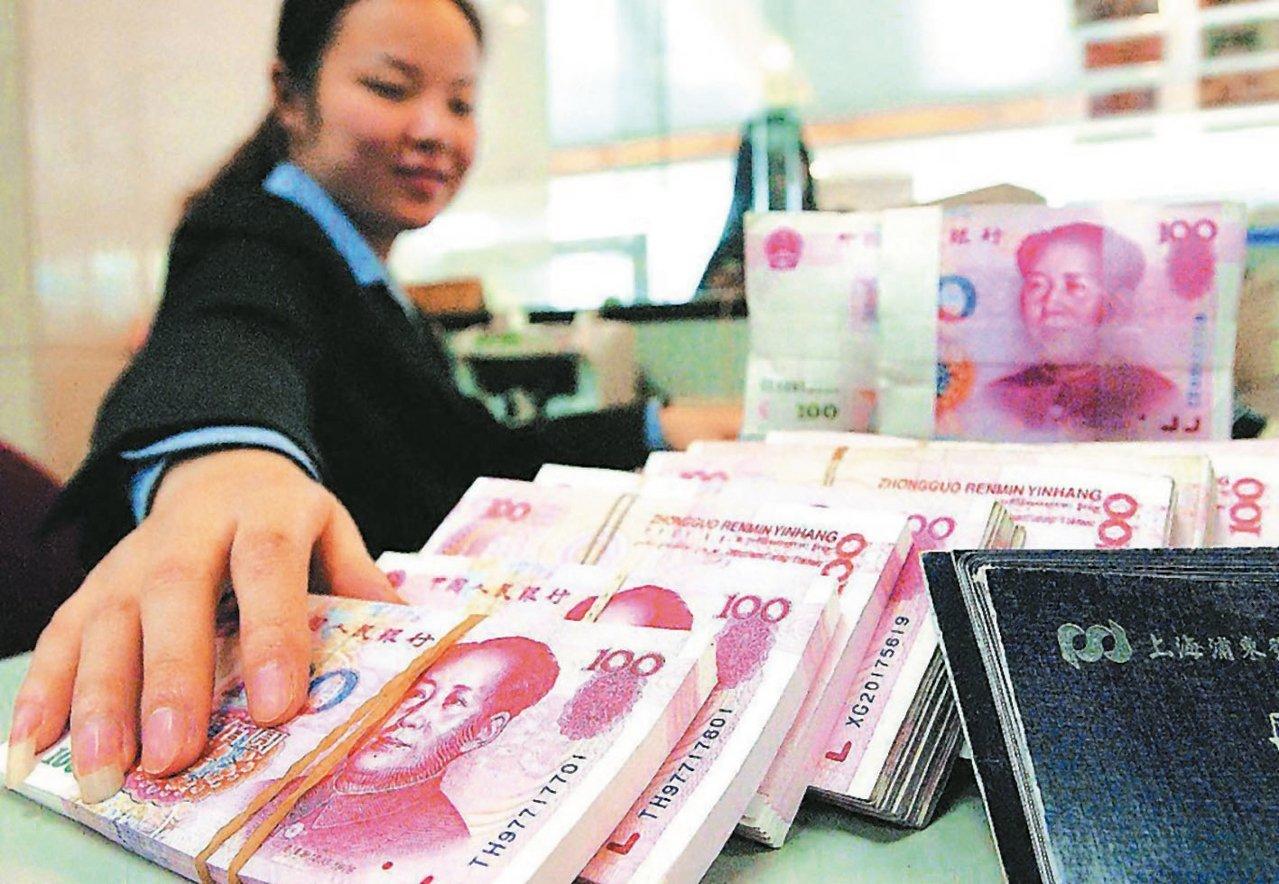 大陸1月新增人民幣貸款將創歷史新高,截至周二調查結果,分析師對1月新增貸款的預估...