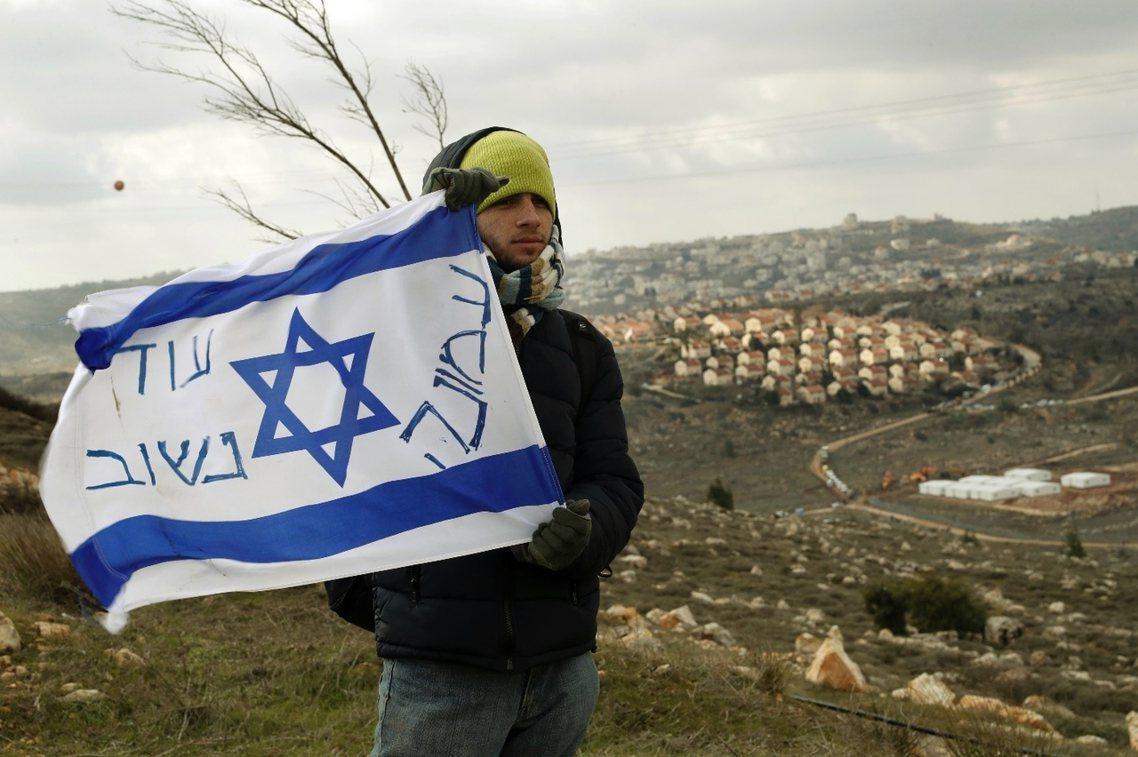 強力保送非法屯墾區:以色列通過「竊國法案」。 圖/法新社