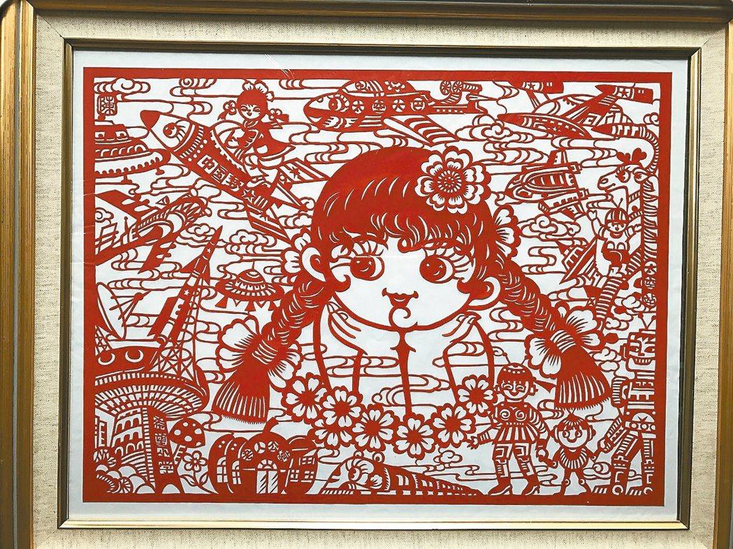 現代化剪紙內容包羅萬象,這幅名為「中國夢」的剪紙作品上面有飛機、老人公寓、希望小...