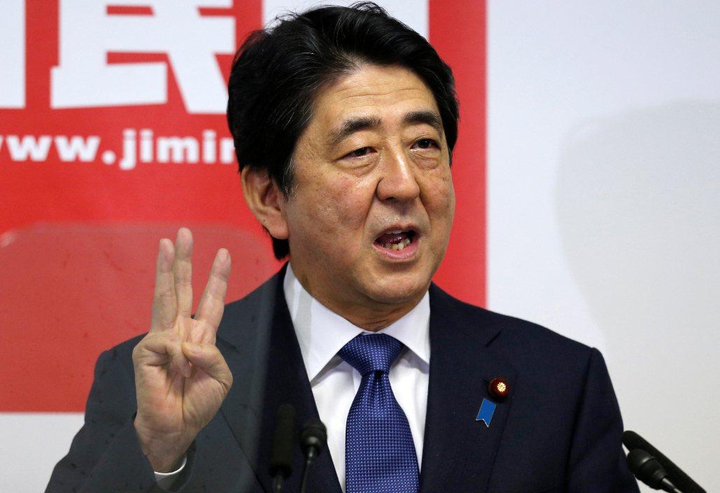 日本首相安倍晉三力推「安倍經濟學」。美聯社