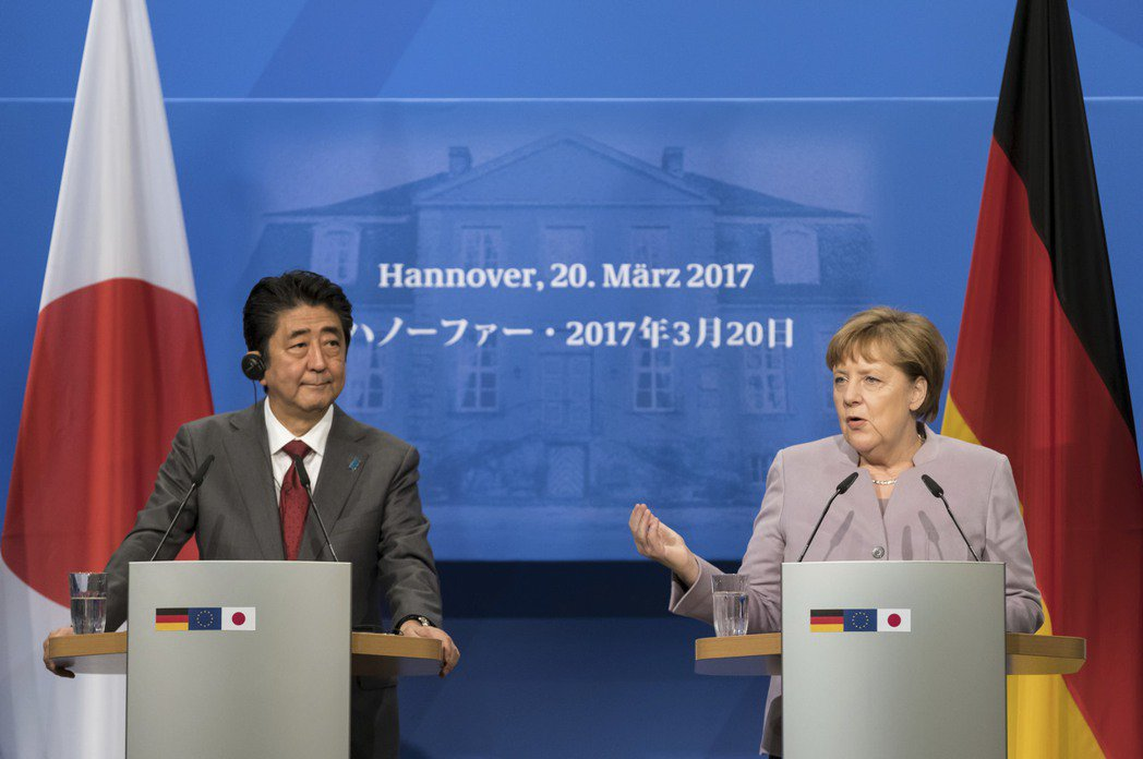 日本首相安倍晉三與德國總理梅克爾。美聯社