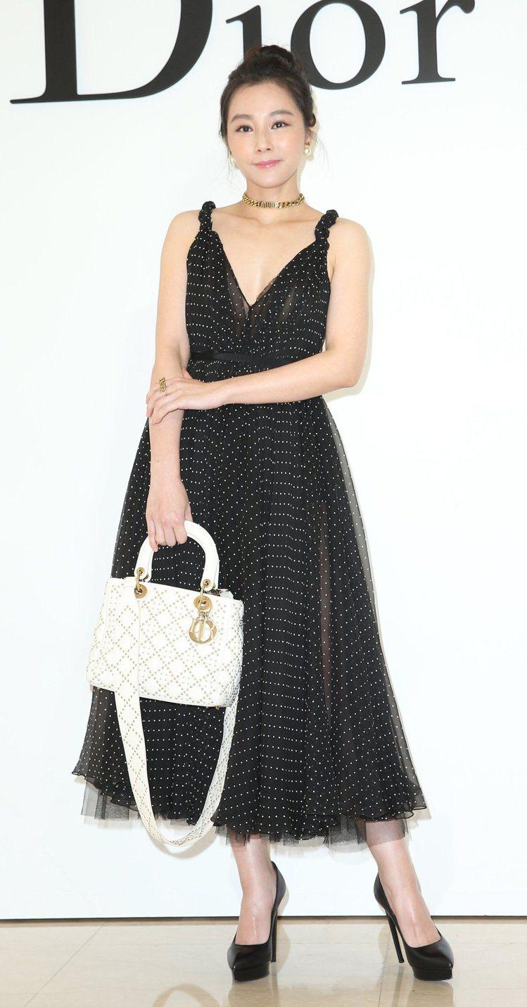 陳怡蓉之前穿著DIOR黑色波點絲質裙裝出席微風廣場專門店開幕活動。圖/記者林澔一...