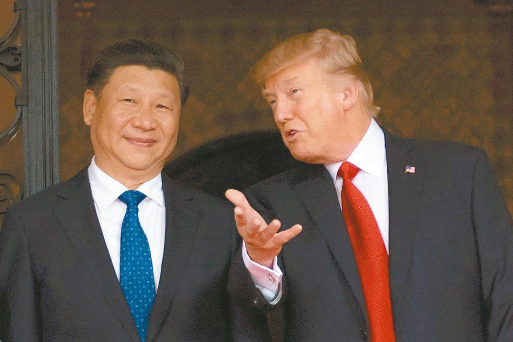 川席會後,川普改口說中國不是貨幣操縱國。 (法新社)