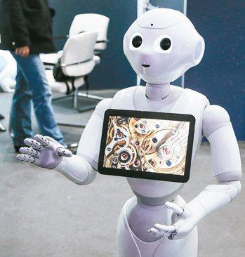 新型機器人可以跟人類互動、管理倉儲,取代人類工作的趨勢日益明顯。 路透、歐新社