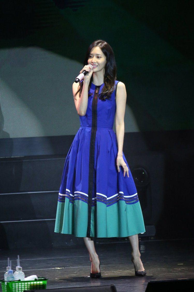 潤娥年初訪台時穿過膝洋裝,巧妙遮住不完美的腿型。圖/本報系資料照片