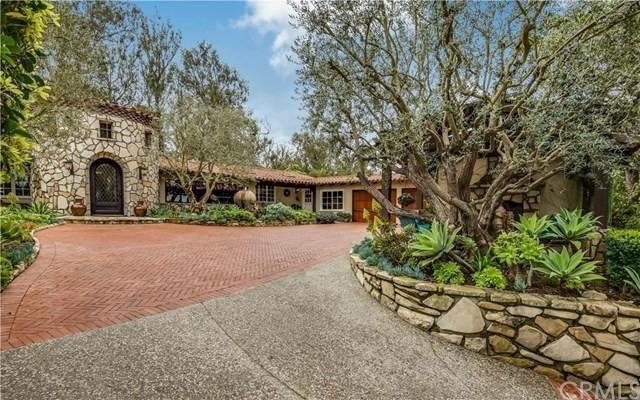 這棟豪宅位於派洛斯福德斯的一片私人區域內,極具私密性。(Realtor.com)