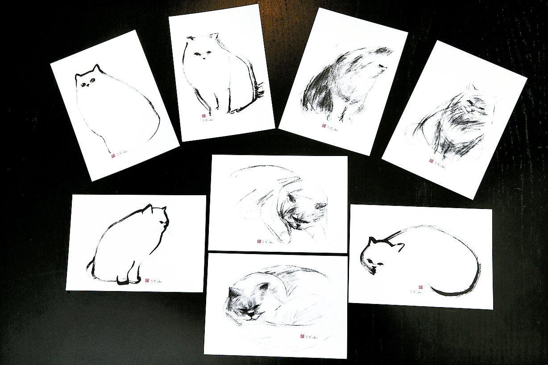 愛貓的朱守谷,也喜歡畫貓。 記者蘇健忠/攝影