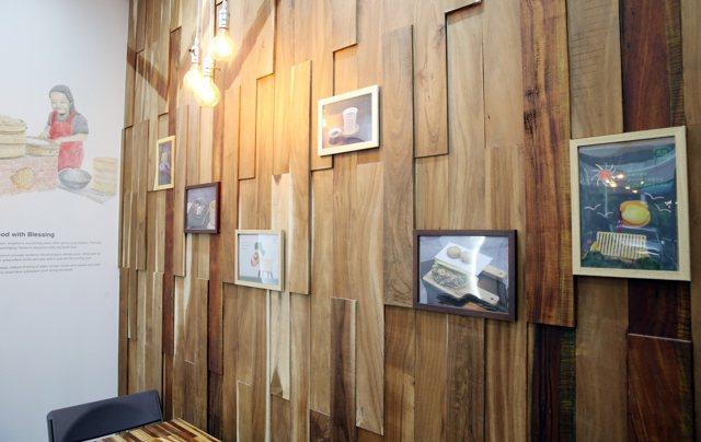 牆面使用台灣原生相思木製作,風格清新溫暖。