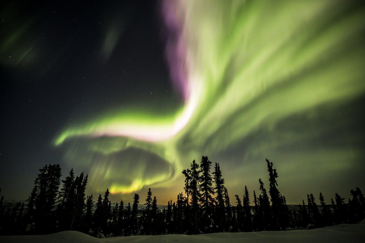 黃刀鎮號稱一年中有250天可看見極光。圖/加拿大航空提供