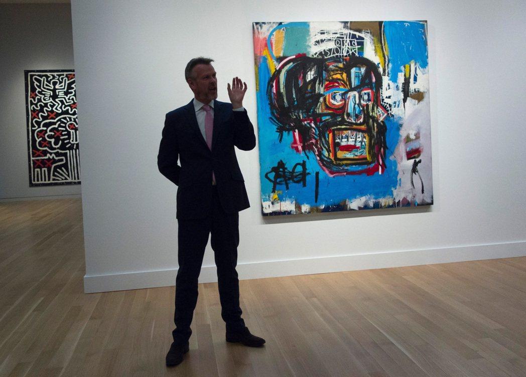 美國已逝藝術家巴斯奇亞一幅名為「無題」的畫作,18日在紐約蘇富比拍賣會被日本收藏...