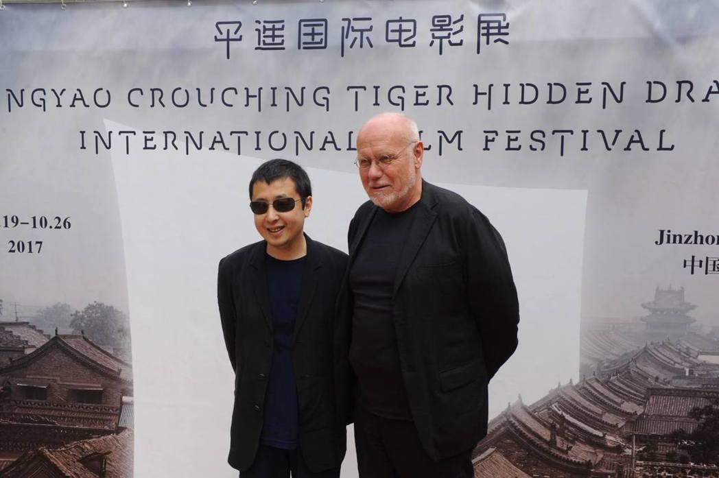 大陸名導演賈樟柯(左)在坎城影展宣傳平遙國際電影節。右為前威尼斯影展主席馬可穆勒...