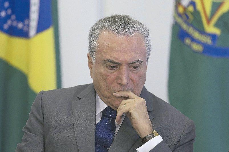 巴西最高選舉法院本周將宣布,前總統羅賽芙和時任副總統的現任總統泰梅爾(圖)201...