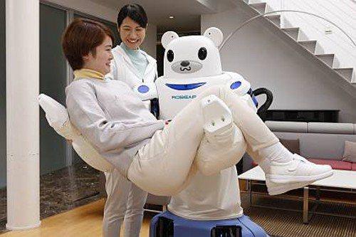 ROBEAR看護支援機器人,可公主抱,或將雙臂繞過對方腰部,幫助受照顧者站立。 ...