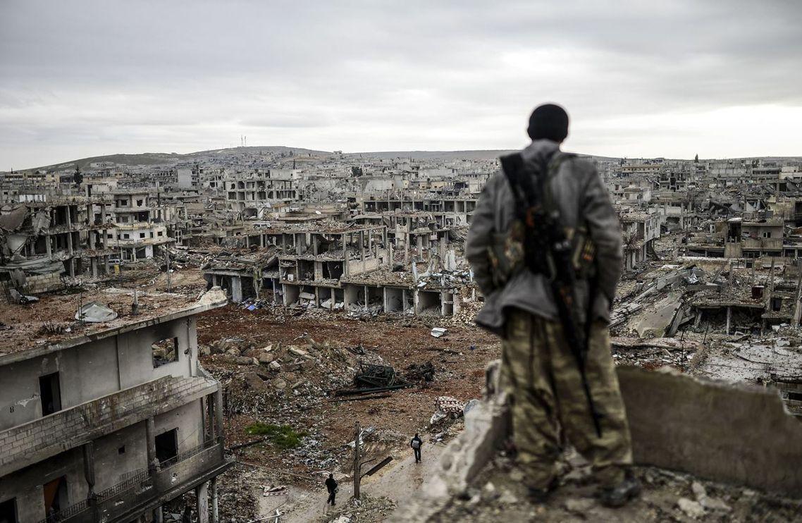 硬扛柱ISIS壓力的不死軍,終於收復已成廢墟的辛賈爾。 圖/法新社