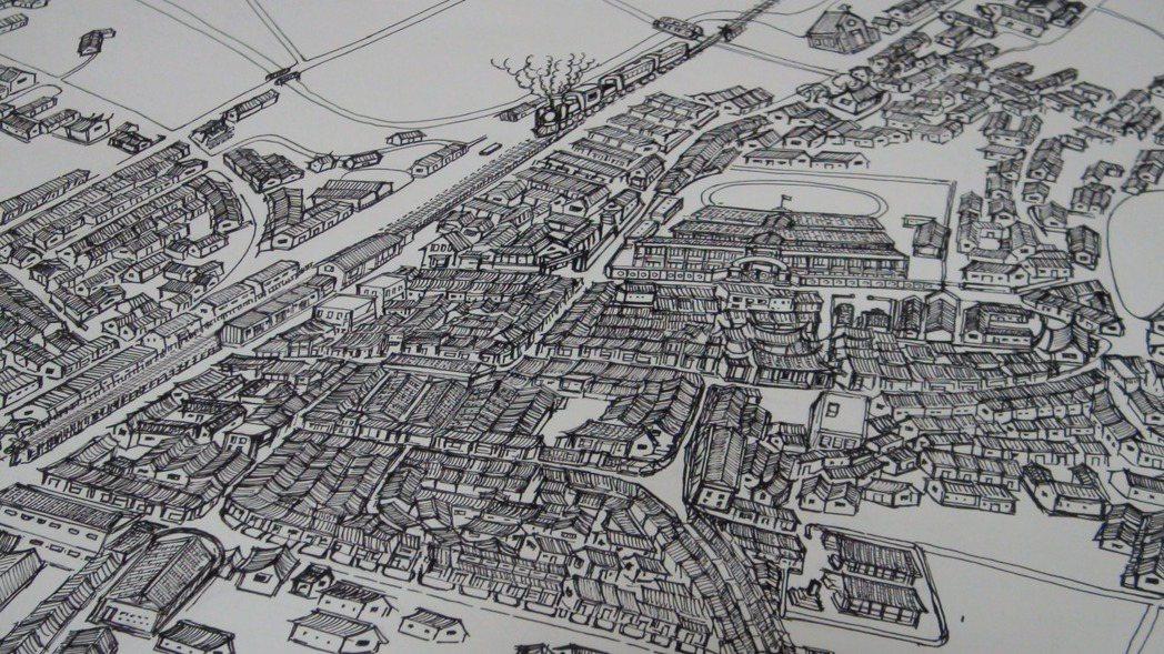 從小喜歡繪畫的吳嘉文,用心描繪出早期民雄鬧區地圖。 記者謝恩得/攝影