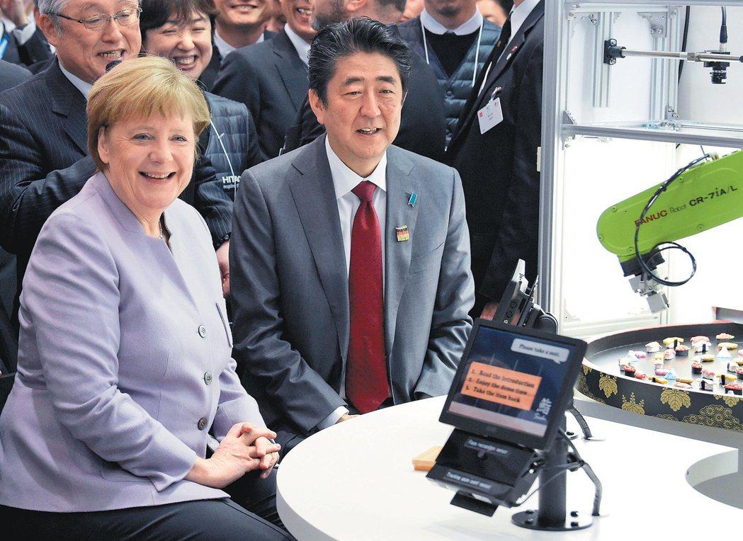 日本和歐盟傳出即將談成規模龐大的自由貿易協定,最快本周宣布。圖為德國總理梅克爾(...