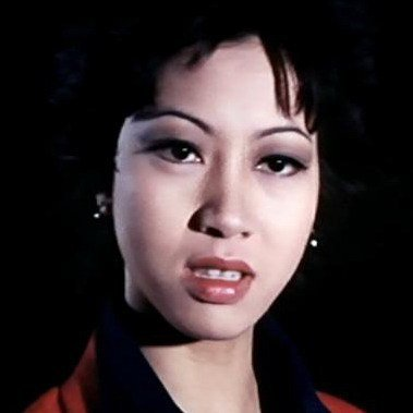 元秋在「女警察」有精心打扮的亮麗畫面。圖/摘自HKMDB