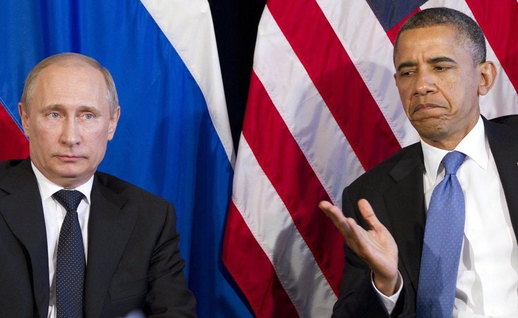 2012年6月18日,當時的美國總統歐巴馬(右)與俄國總統普亭在墨西哥的G20高...