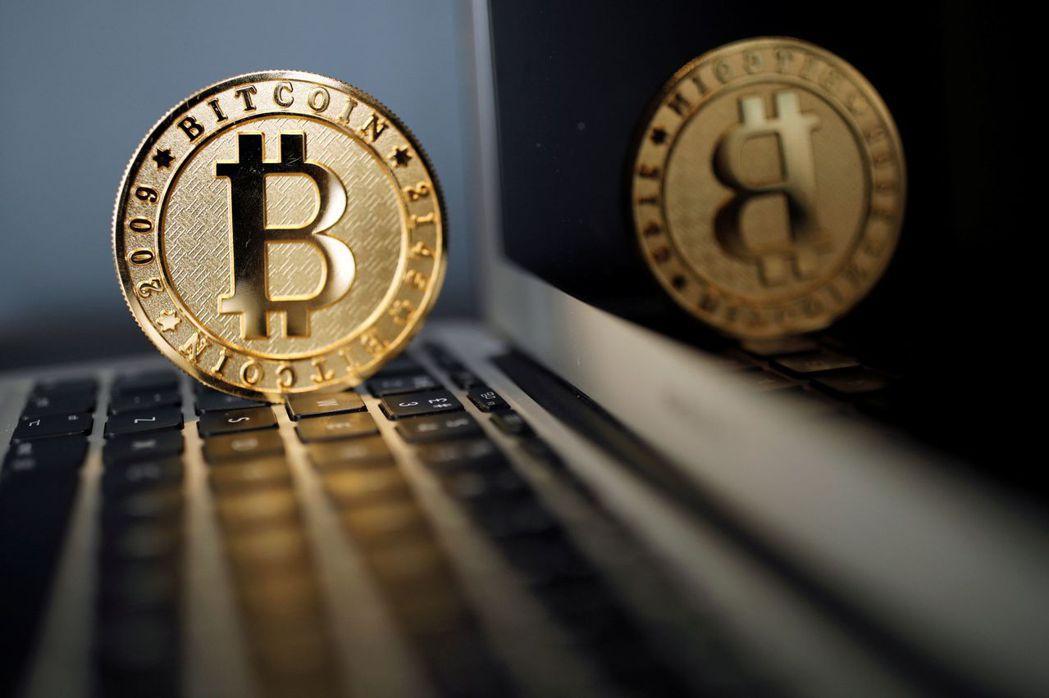 虛擬貨幣今年來暴漲暴跌,想參與商機的民眾不少。 路透
