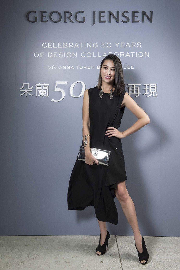 名媛黃景俐一襲黑色洋裝凸顯俐落短髮。圖/喬治傑生提供