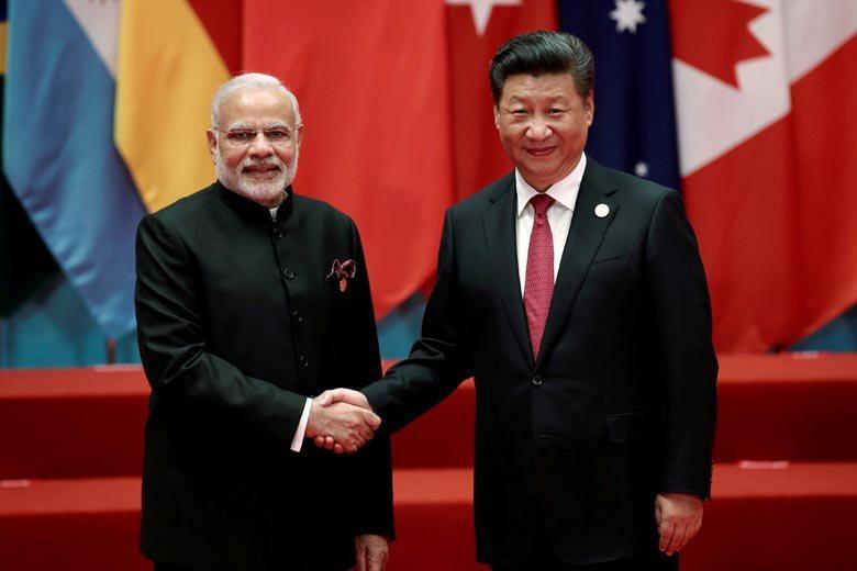 圖為2016年中國國家主席與印度總理莫迪在G20會議上握手合影畫面。 圖/路透社