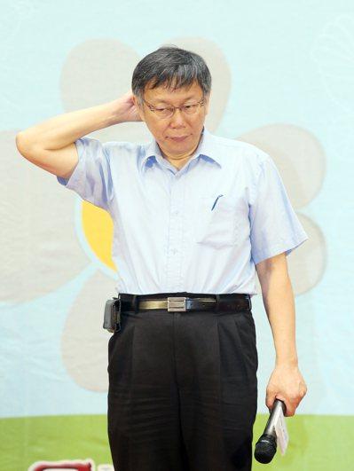台南市政府宣布停班停課大轉彎,被市民罵翻了,台北市長柯文哲出面緩頰。 本報資料照...