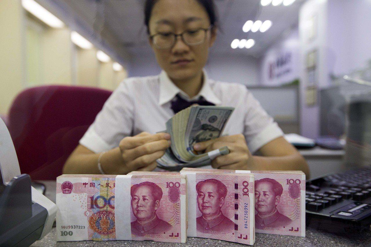 人民幣對美元匯率有走高。中新社