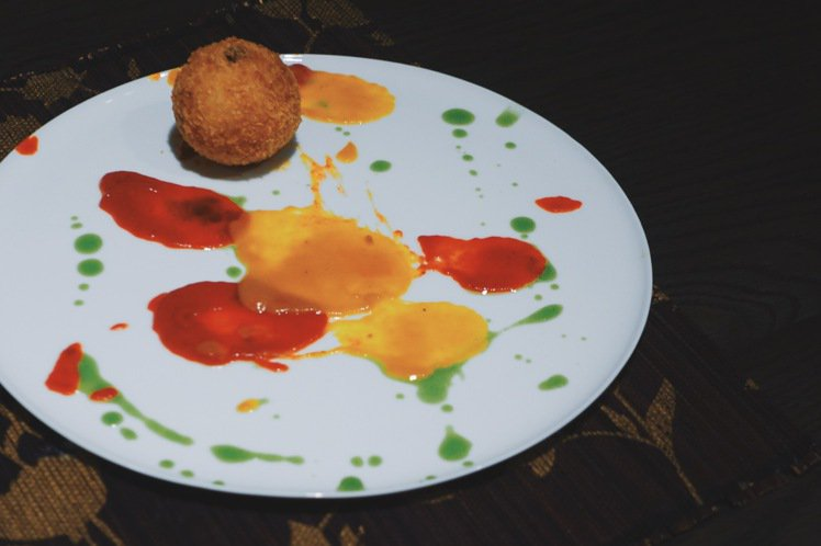 Arancino,西西里炸飯糰是義大利南方西西里島經典家鄉菜。圖/PJ攝影