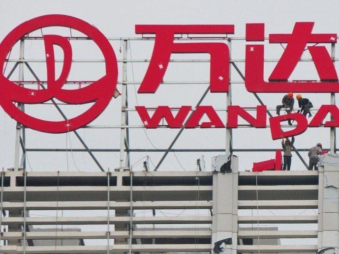 中共黨媒《人民日報》文章提到萬達集團高調甩賣資產,把去槓桿做得更加決絕。(取自網...