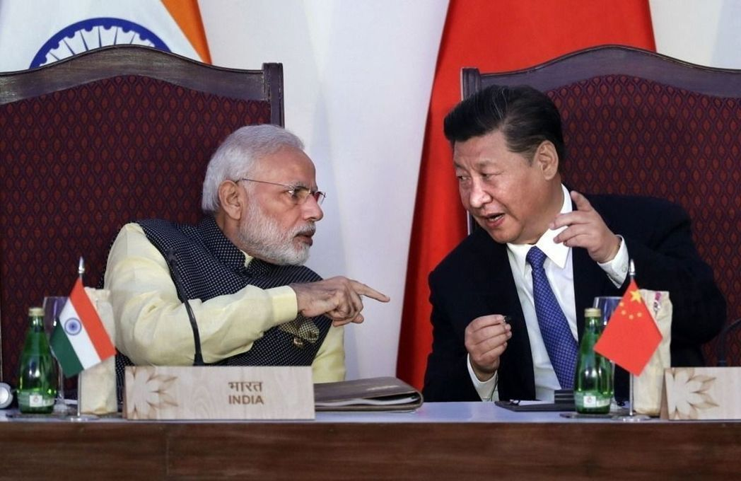 圖為2016年金磚五國峰會時印度總理莫迪與中國領導人習近平會晤畫面。 圖/美聯社