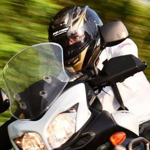 國民黨台中市黨部主委陳明振平日愛騎重機,享受風裡來去的快感 。圖/陳明振提供