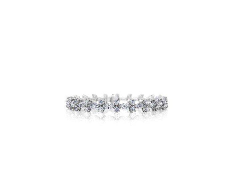 莫文蔚於雞尾酒會時配戴De Beers Idalia鑽石手鍊,鑽石總重8.19克...