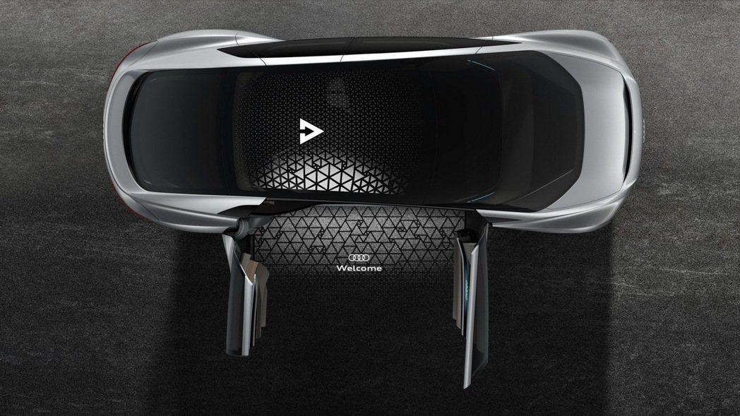 Aicon所搭載的全新LED燈科技不再僅有照明功能,逐漸進化至全新的LED燈群可形成像瞳孔般表情,甚至能與外界進行「眼神交會」,提醒周圍交通路況。 圖/台灣奧迪提供