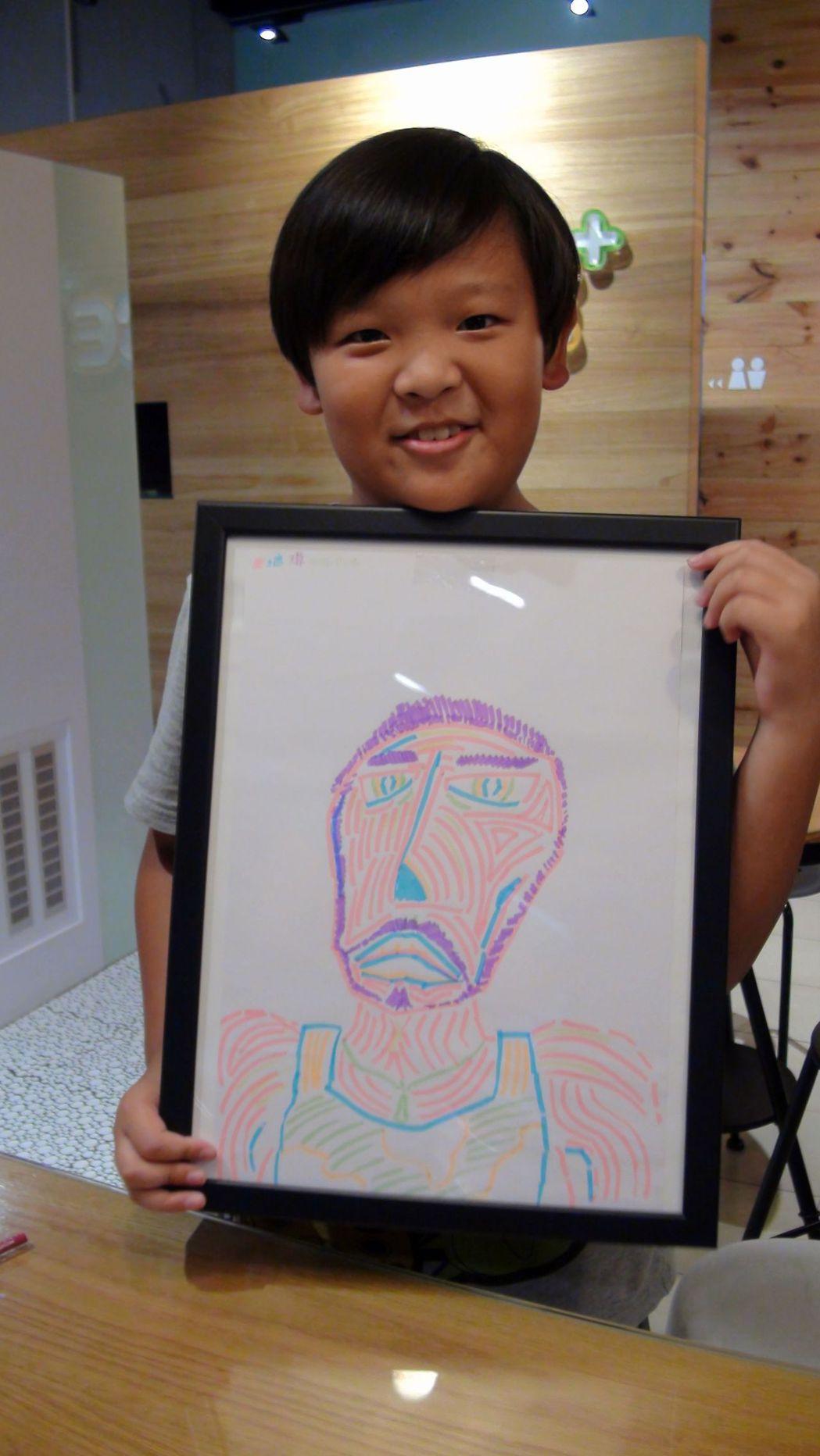 吳培瑋與他的人像創作。記者王昭月/攝影