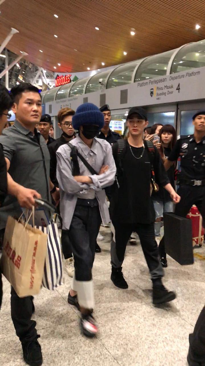 G-Dragon 16日抵達馬來西亞,全身裹得嚴實。圖/IME提供