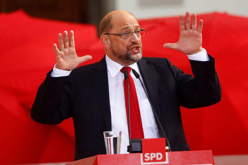 舒爾茲的社民黨(SPD),還願意與梅克爾的基民黨再組「大聯合政府」嗎? 圖/路透...