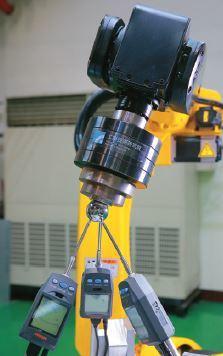 機器手臂精度大幅進化,已逐漸超越目前國際上精度校正軟體廠商的技術水準。 圖片提供...