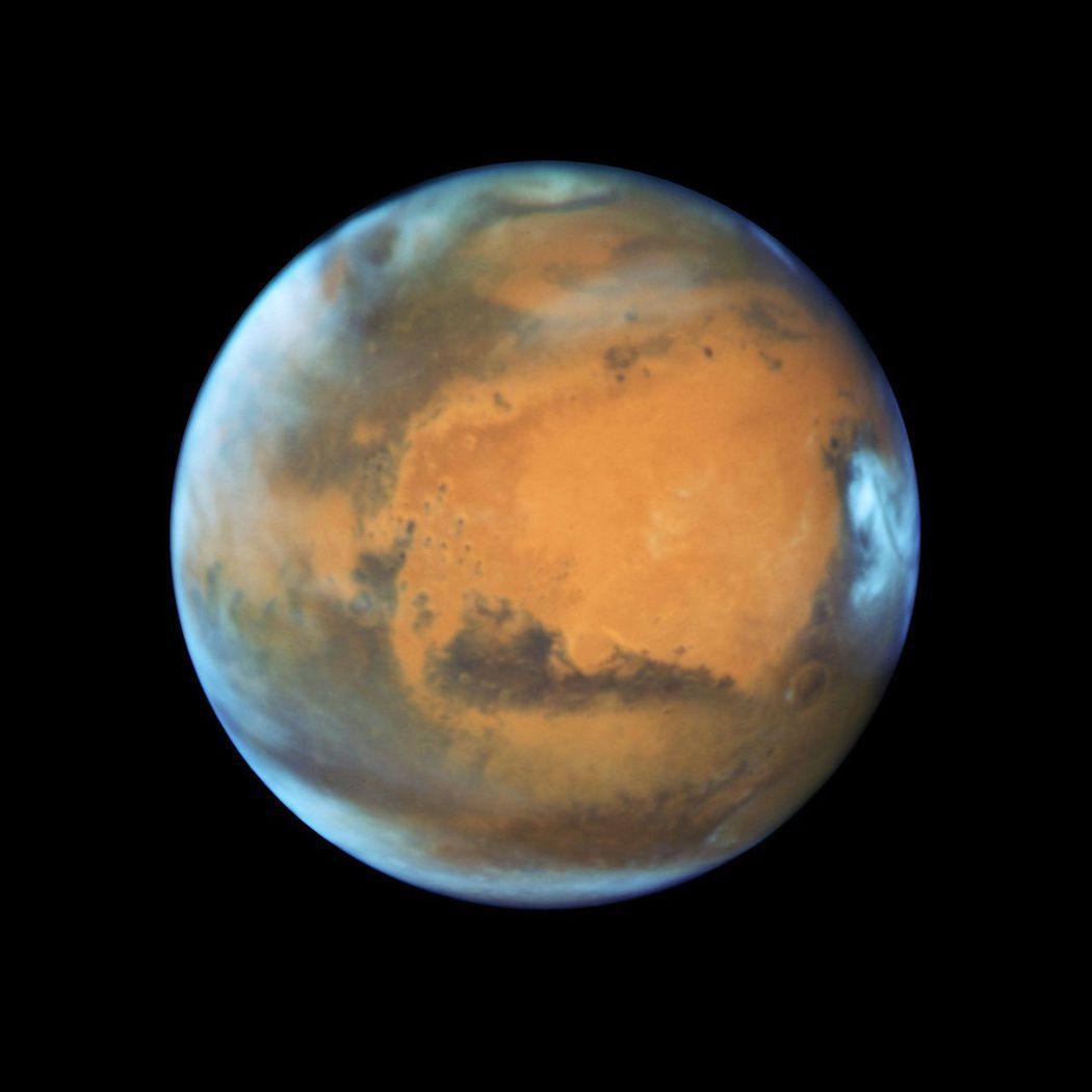 哈伯望遠鏡拍攝的火星照片。移民火星,人類夢想何時圓? (路透)