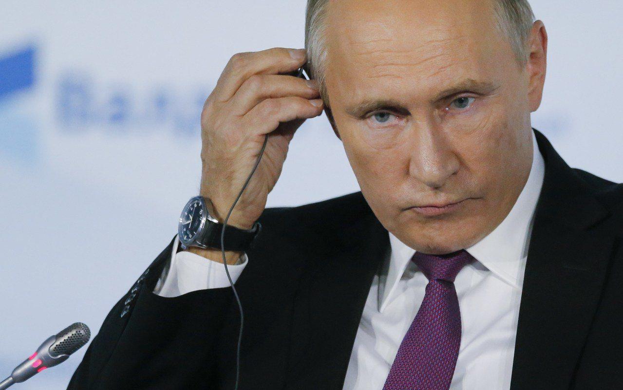 俄羅斯總統普亭在索契一場會上表示,俄羅斯密切關注中共19大。(路透)