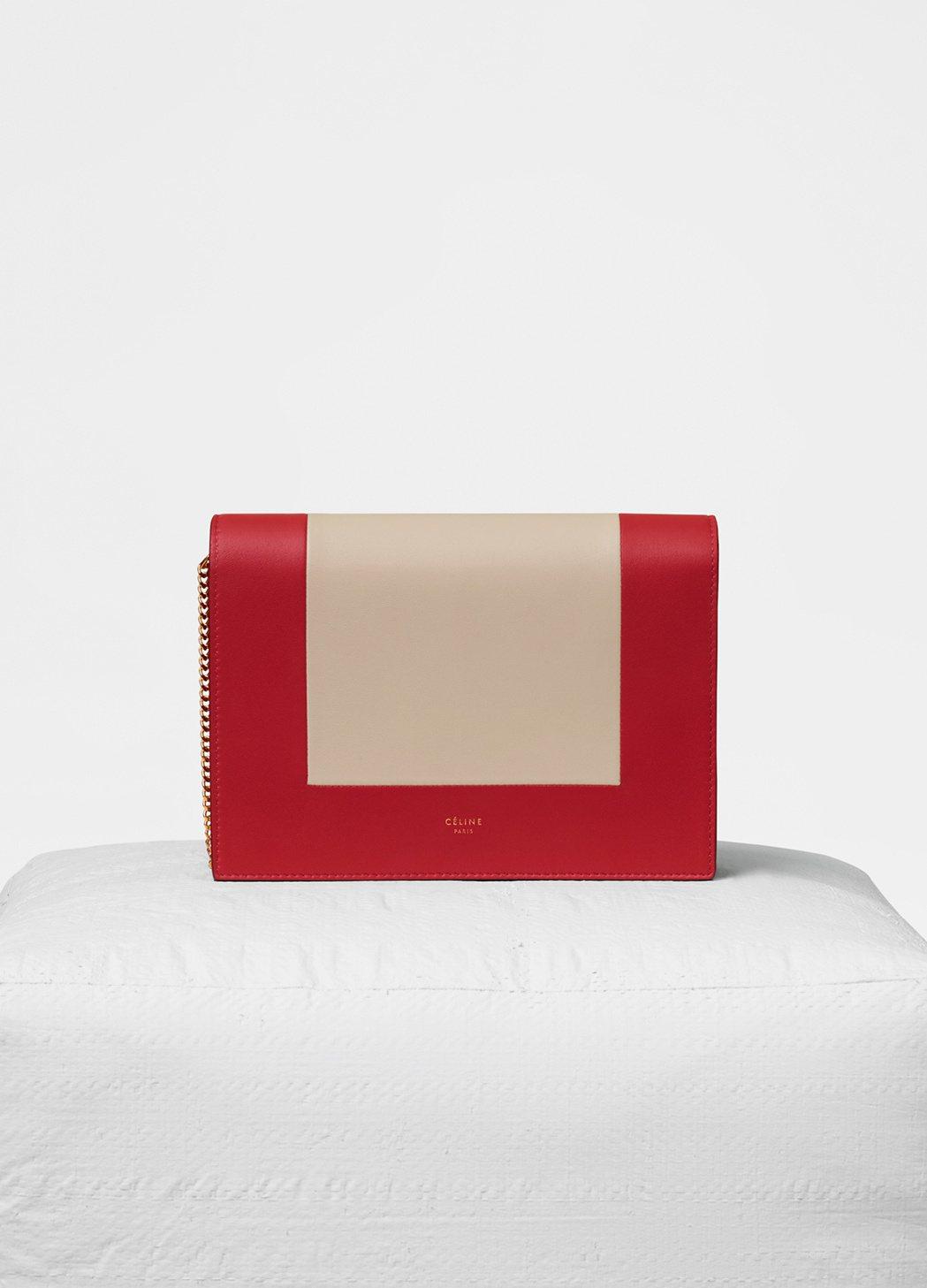 Frame紅白拼色小羊皮鍊帶手拿包,售價43,500元。圖/CÉLINE提供