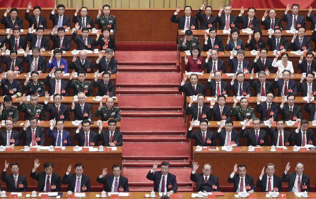 中共第十九次全國代表大會在北京人民大會堂閉幕。 中新社
