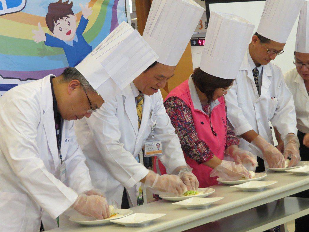 大千健康醫療體系總裁徐千剛(左二)、癌症中心主任黃明立(左一)等人動手製作糖果蔬...