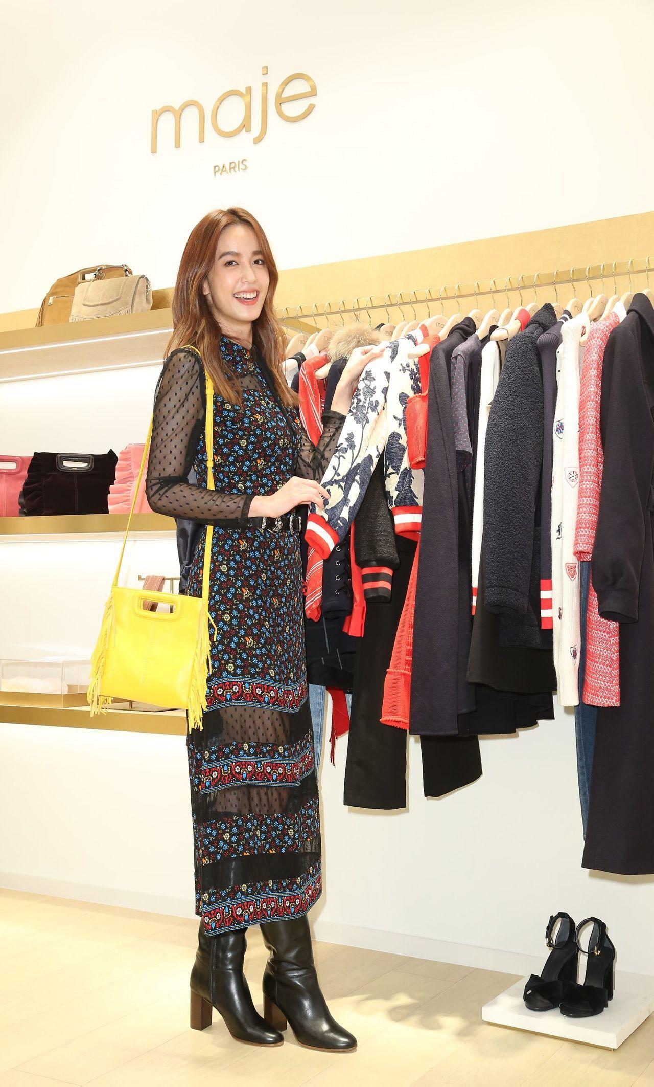 陳庭妮選擇黃色M Bag配襯印花蕾絲鏤空裙裝穿出跳色效果。記者陳立凱/攝影