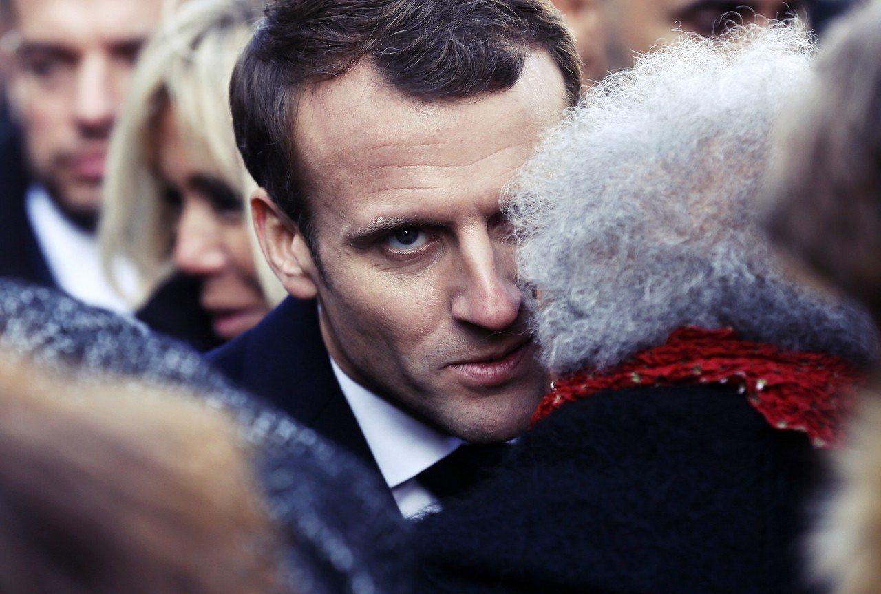對於法國總統馬克宏而言,加泰隆尼亞獨立是一「痛苦的時刻」。 圖/美聯社