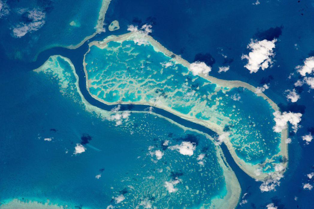 澳洲大堡礁幅員比日本還大,從太空都清晰可見。(歐新社)