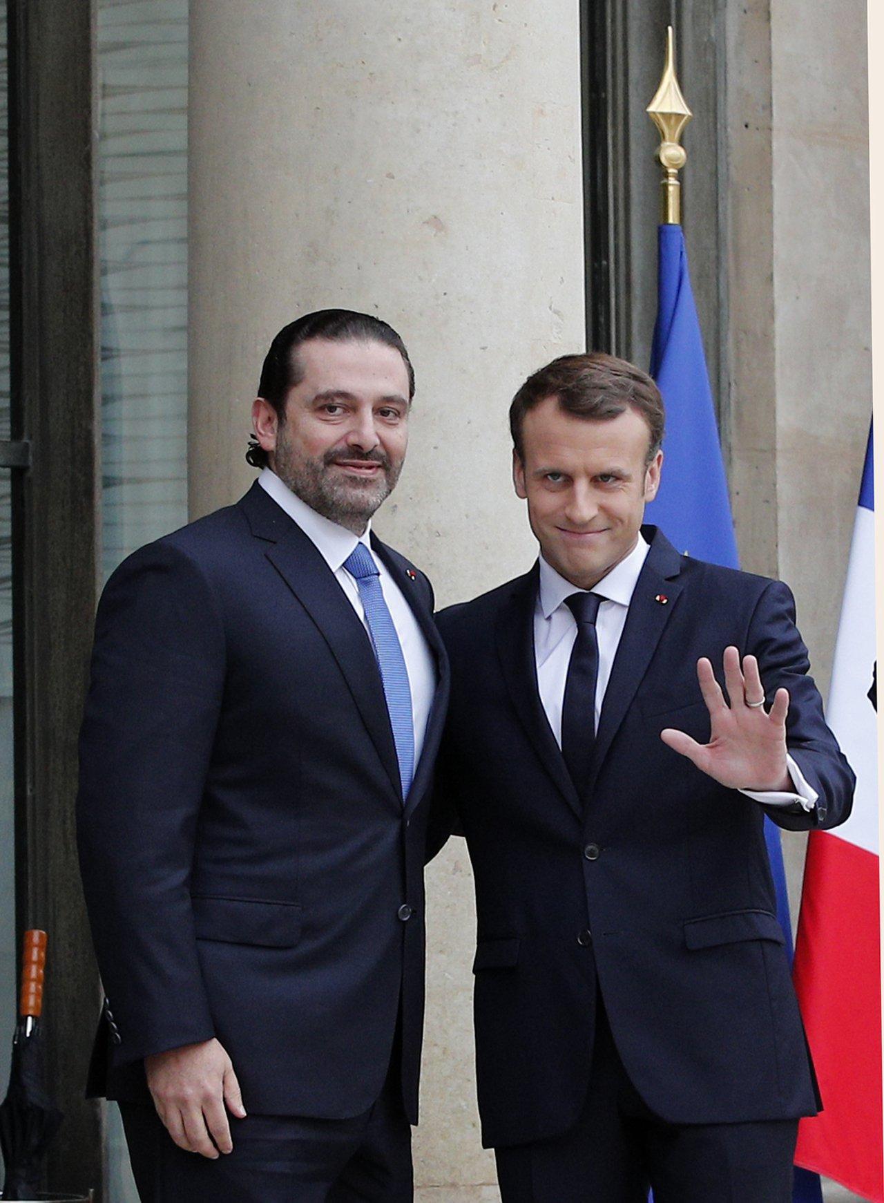 哈里里在巴黎與法國總統馬克宏進行會談。 美聯社